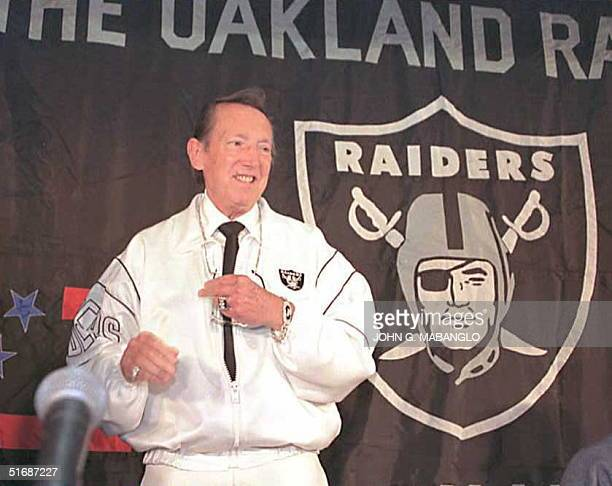 Al Davis the owner of the Oakland Raiders smiles as he faces reporters and photographers after a press conference at the Oakland Alameda County...