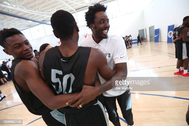 Al FarouqAminu of Team Africa participates with the campers at Hoops 4 Hope at the Basketball Without Boarders Africa program at the American...