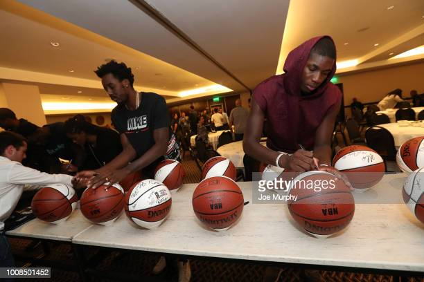 Al FarouqAminu of the Portland Trail Blazers and Cheick Diallo of the New Orleans Pelicans signs balls at the Hyatt Regency Hotel on July 31 2018 in...