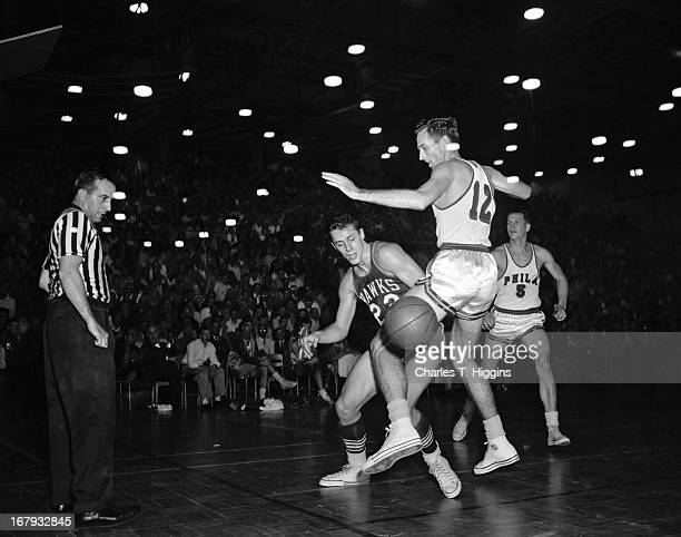 Al Ferrari of the St Louis Hawks battle for the ball against Walt Davis of the Philadelphia Warriors during a game played on January 11 1956 at the...