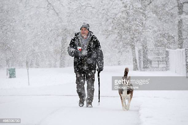 Al Frelk walks his dog Shiba in Lords Park in Elgin Ill on Saturday Nov 21 2015 Asked about the snow Frelk said It's beautiful but can be tough to...