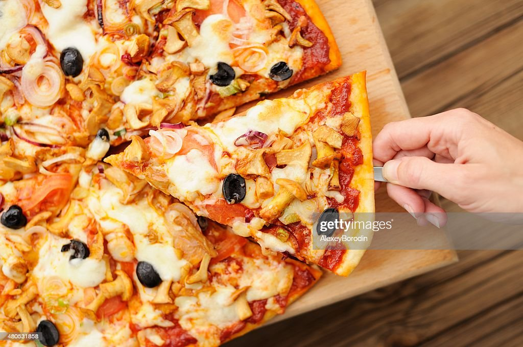 Al funghi pizza cut in sectors with one piece : Stock Photo