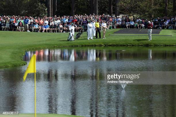 Al Geiberger of the United States skips a ball on the 16th hole during a practice round prior to the start of the 2014 Masters Tournament at Augusta...