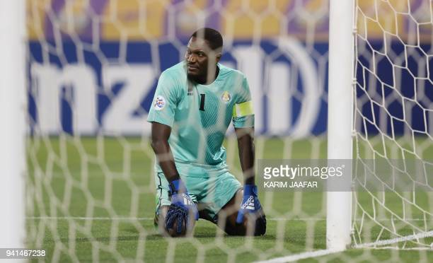 Al Gharafa's goalkeeper Qasem Aboullhamed Burhan looks on during the AFC Champions League match between Qatar's alGharafa and UAE's AlJazira at the...