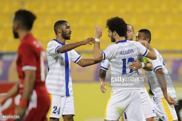 al Gharafa's Muayed Hassan Hassan and Ahmed Alaaeldin Abdelmotaal celebrate after scoring a goal during the AFC Champions League match between...