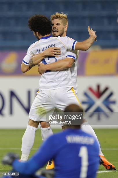 Al Gharafa's Portuguese midfielder Diogo Carlos Amado and Ahmed Alaaeldin Abdelmotaal celebrate after scoring a goal during the AFC Champions League...