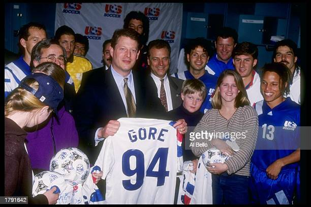 Al Gore stands with members of the USA Soccer team during the Joe Robbie Cup at Joe Robbie Stadium in Miami Florida
