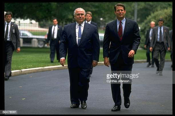 VP Al Gore walking on driveway to WH w visiting Russian PM Viktor Chernomyrdin