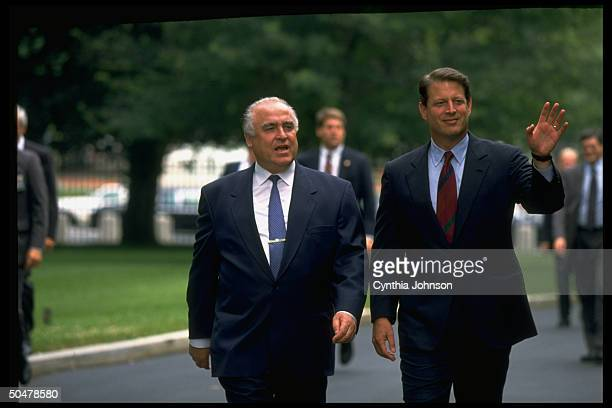 VP Al Gore waving walking on driveway to WH w visiting Russian PM Viktor Chernomyrdin