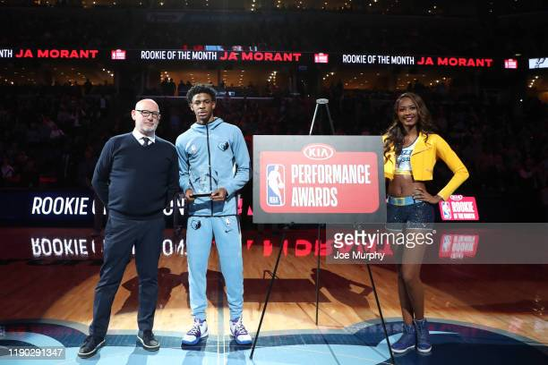 Al Gosset presents Ja Morant of the Memphis Grizzlies the Rookie of the Month award before game against the San Antonio Spurs on December 23, 2019 at...