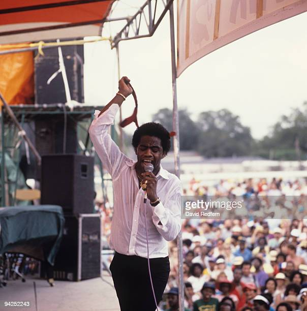 Al Green removes his tie as he performs on stage at the New Orleans Jazz and Heritage Festival in New Orleans, Louisiana on April 29, 1984.