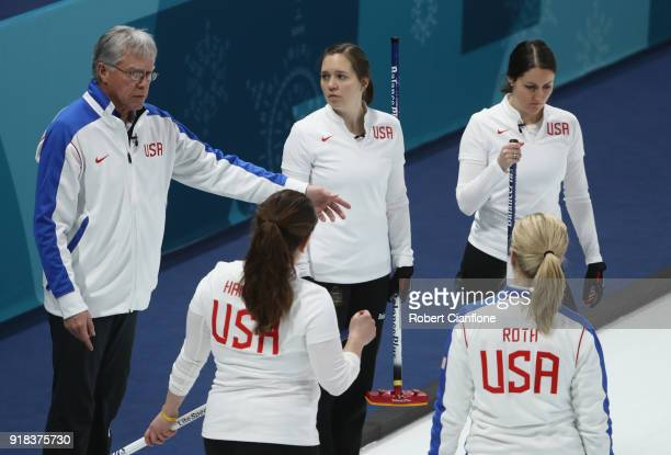 Al Hackner coach of the United States talks to Becca Hamilton Nina Roth Tabitha Peterson and Aileen Geving during the Curling Women's Round Robin...