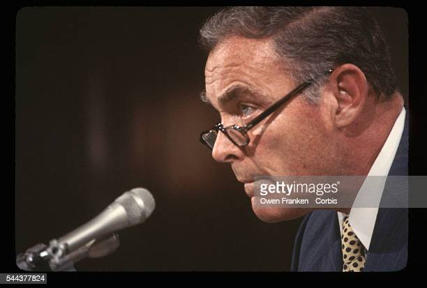 Al Haig Listening Intently at Microphone
