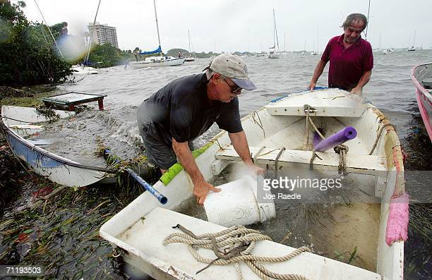 Al Hale and Charlie Johnson bail out a dingy after it broke loose from its' moorings on June 13 2006 in Sarasota Florida The first named storm of the...