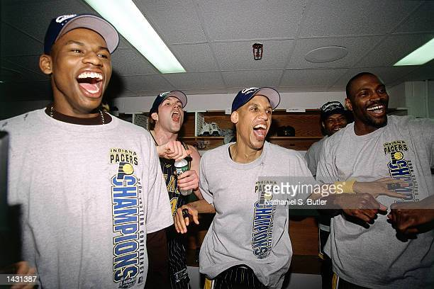 Al Harrington, Austin Croshere, Reggie Miller and Dale Davis of the Indiana Pacers celebrate in the lockerroom after winning game 6 of the Eastern...