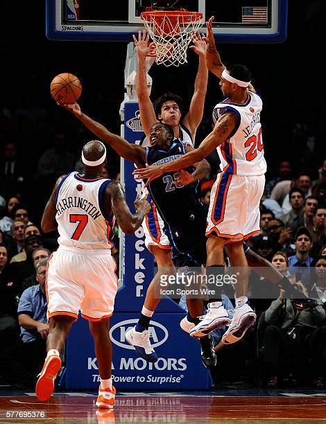 Al Harrington Danilo Gallinari and Jared Jeffries of the New York Knicks guard Wesley Matthews of the Utah Jazz in the first half at Madison Square...