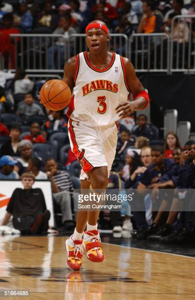 Al Harrington of the Atlanta Hawks brings the ball upcourt against the Memphis Grizzlies during the preseason game on October 20 2004 at Philips...