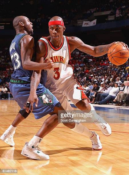 Al Harrington of the Atlanta Hawks drives against the Minnesota Timberwolves in a game on October 14 2004 at the BJCC Arena in Birmingham Alabama...