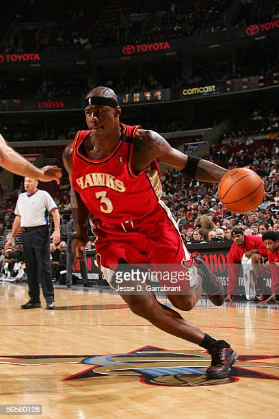 Al Harrington of the Atlanta Hawks drives against the Philadelphia 76ers December 14 2005 at the Wachovia Center in Philadelphia Pennsylvania The...