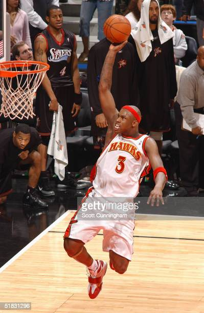 Al Harrington of the Atlanta Hawks goes up for a dunk against the Philadelphia 76ers during a game on December 6 2004 at Philips Arena in Atlanta...