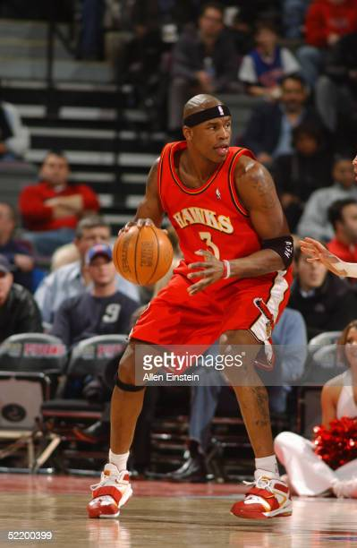 Al Harrington of the Atlanta Hawks moves the ball against of the Detroit Pistons during the game on February 2 2005 at the Palace of Auburn Hills in...