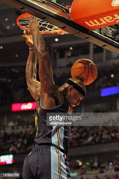 Al Harrington of the Denver Nuggets bounces the ball off of his head after dunking against the Chicago Bulls at the United Center on March 26 2012 in...