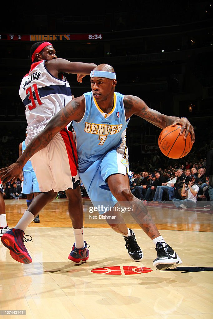 Al Harrington #7 of the Denver Nuggets drives against Chris Harrison #31 of the Washington Wizards during the game at the Verizon Center on January 20, 2012 in Washington, DC.