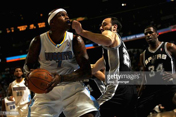 Al Harrington of the Denver Nuggets looks to take a shot against Manu Ginobili of the San Antonio Spurs at the Pepsi Center on March 23 2011 in...