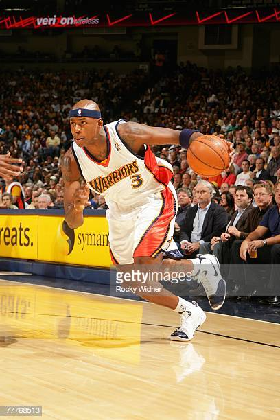 Al Harrington of the Golden State Warriors drives to the basket during the game against the Utah Jazz on October 30 2007 at Oracle Arena in Oakland...