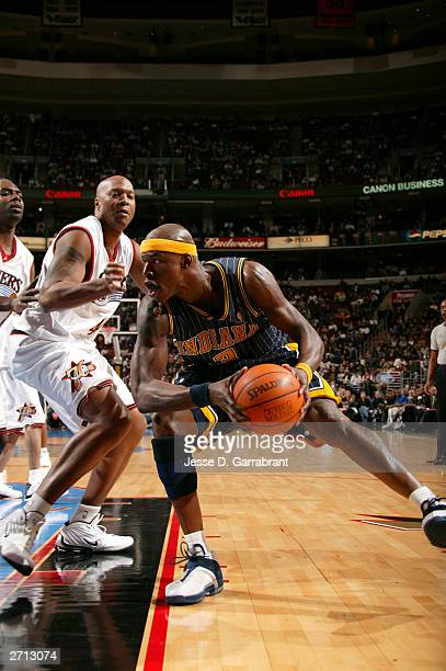 Al Harrington of the Indiana Pacers drives against Derrick Coleman of the Philadelphia 76ers November 9, 2003 at the Wachovia Center in Philadelphia,...