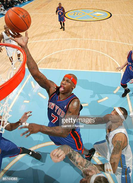 Al Harrington of the New York Knicks goes to the basket against Kenyon Martin of the Denver Nuggets on March 31, 2009 at the Pepsi Center in Denver,...