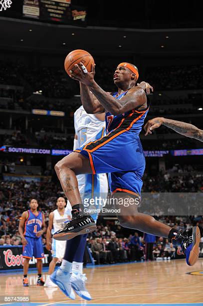 Al Harrington of the New York Knicks goes to the basket against the Denver Nuggets on March 31, 2009 at the Pepsi Center in Denver, Colorado. NOTE TO...