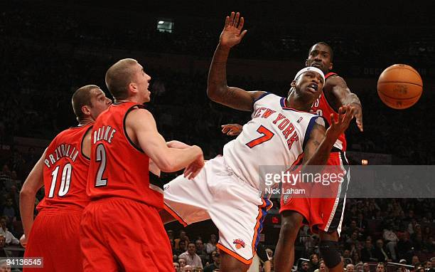 Al Harrington of the New York Knicks has the ball blocked by Martell Webster of the Portland Trail Blazers at Madison Square Garden on December 7...