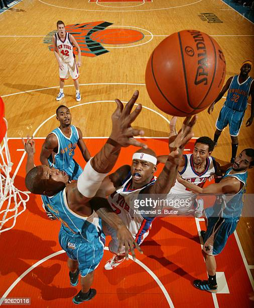 Al Harrington of the New York Knicks shoots against David West of the New Orleans Hornets on November 2 2009 at Madison Square Garden in New York...