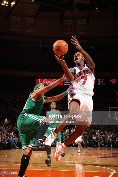 Al Harrington of the New York Knicks shoots against Eddie House of the Boston Celtics on October 20 2009 at Madison Square Garden in New York City...