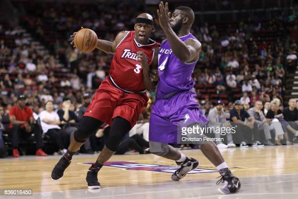 Al Harrington of the Trilogy handles the ball against Ivan Johnson of the Ghost Ballers in week nine of the BIG3 threeonthree basketball league at...