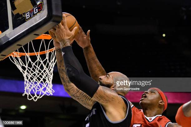 Al Harrington of Trilogy blocks a lay up attempt Carlos Boozer of Ghost Ballers during the Big3 week 6 game between Ghost Ballers and Trilogy on July...