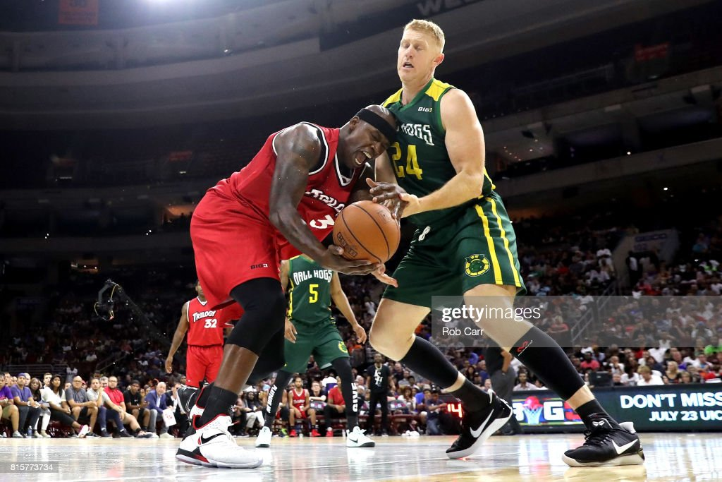 Al Harrington #3 of Trilogy competes for the ball with Brian Scalabrine 324 of the Ball Hogs during week four of the BIG3 three on three basketball league at Wells Fargo Center on July 16, 2017 in Philadelphia, Pennsylvania.