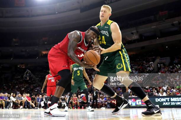Al Harrington of Trilogy competes for the ball with Brian Scalabrine 324 of the Ball Hogs during week four of the BIG3 three on three basketball...