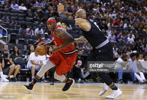 Al Harrington of Trilogy drives against Carlos Boozer of the Ghost Ballers during the BIG3 three on three basketball league at Scotiabank Arena on...