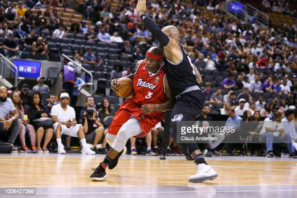 Al Harrington of Trilogy drives into Carlos Boozer of the Ghost Ballers during the BIG3 three on three basketball league at Scotiabank Arena on July...
