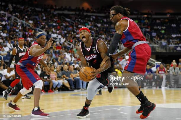Al Harrington of Trilogy drives to the basket against Amar'e Stoudemire and Bonzi Wells of TriState during week eight of the BIG3 three on three...