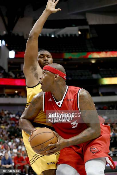 Al Harrington of Trilogy drives to the basket against Metta World Peace of the Killer 3s during week nine of the BIG3 threeonthree basketball league...