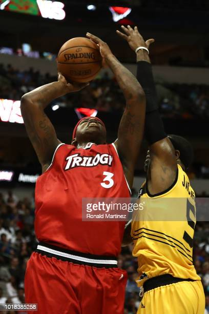 Al Harrington of Trilogy drives to the basket against Stephen Jackson of the Killer 3s during week nine of the BIG3 threeonthree basketball league at...