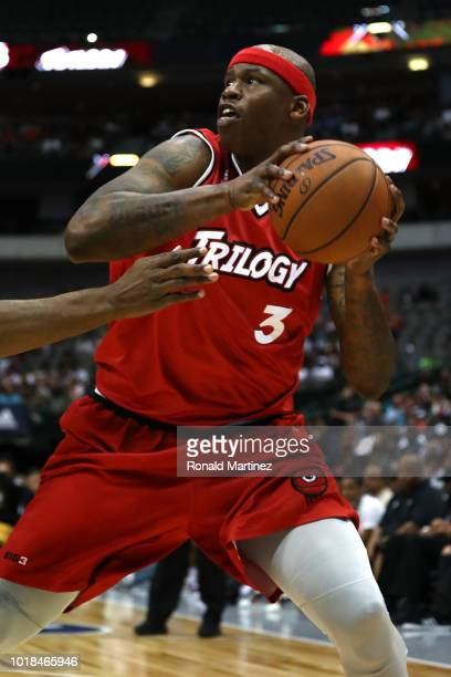 Al Harrington of Trilogy drives to the basket against the Killer 3s during week nine of the BIG3 threeonthree basketball league at the American...