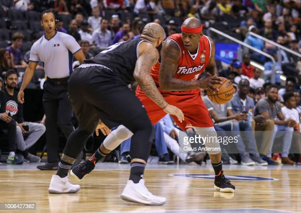 Al Harrington of Trilogy makes a play against Carlos Boozer of the Ghost Ballers during the BIG3 three on three basketball league at Scotiabank Arena...