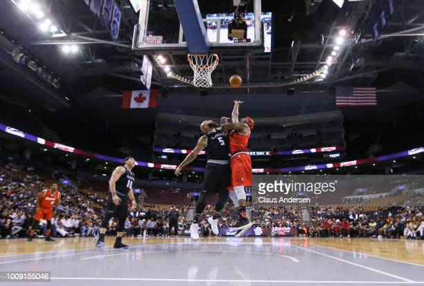 Al Harrington of Trilogy reaches for a rebound against Carlos Boozer of Ghost Ballers during the BIG3 three on three basketball league at Scotiabank...
