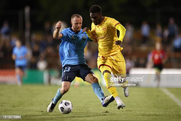 Al Hassan Toure of United and Rhyan Grant of Sydney FC contest the ball during the A-League match between Sydney FC and Adelaide United at Leichhardt...