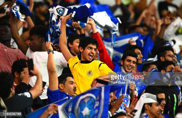 Al Hilal FC fans support their team during the FIFA Club World Cup semifinal match between CR Flamengo and Al Hilal FC at Khalifa International...