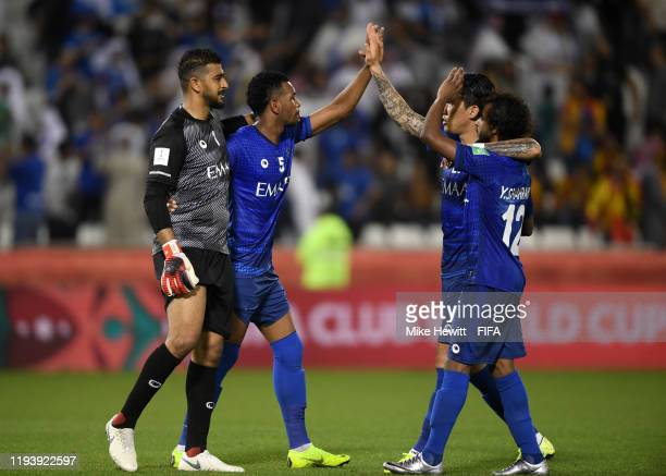Al Hilal players celebrate their sides victory during the FIFA Club World Cup 2nd round match between Al Hilal and Esperance Sportive de Tunis at...